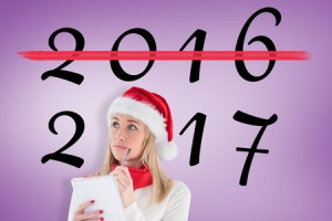 67354367 - festive blonde writing her christmas list against purple vignette