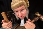 22032231 - grumpy old judge in extreme wide angle closeup with hammer and wig