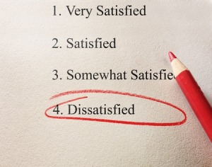 38327771 - dissatisfied survey with red circle and pencil on textured paper