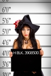 12163756 - mugshot of pretty witch in police station
