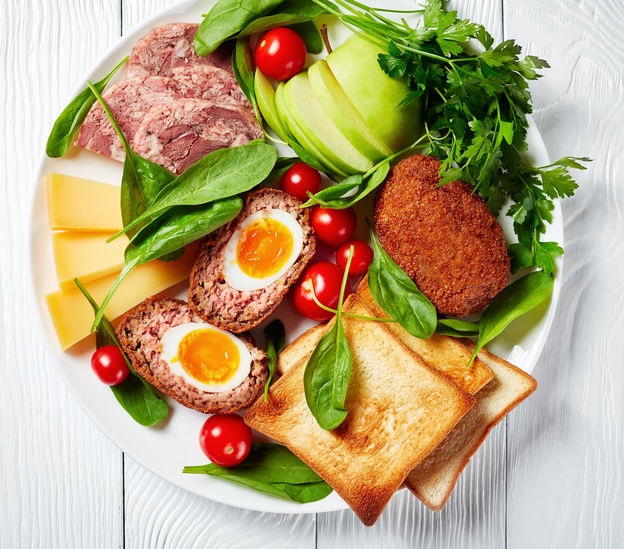 ploughman's lunch on a white plate, top view