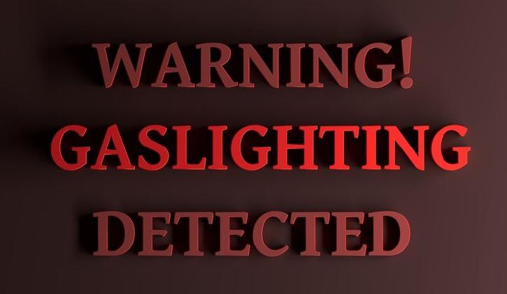 Red words Warning Gaslighting detected