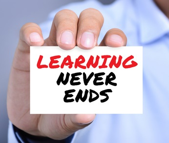 48375735 - learning never ends message on the card shown by a man